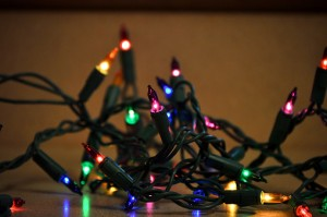 Illuminated string Christmas lights laying on a kitchen counter.